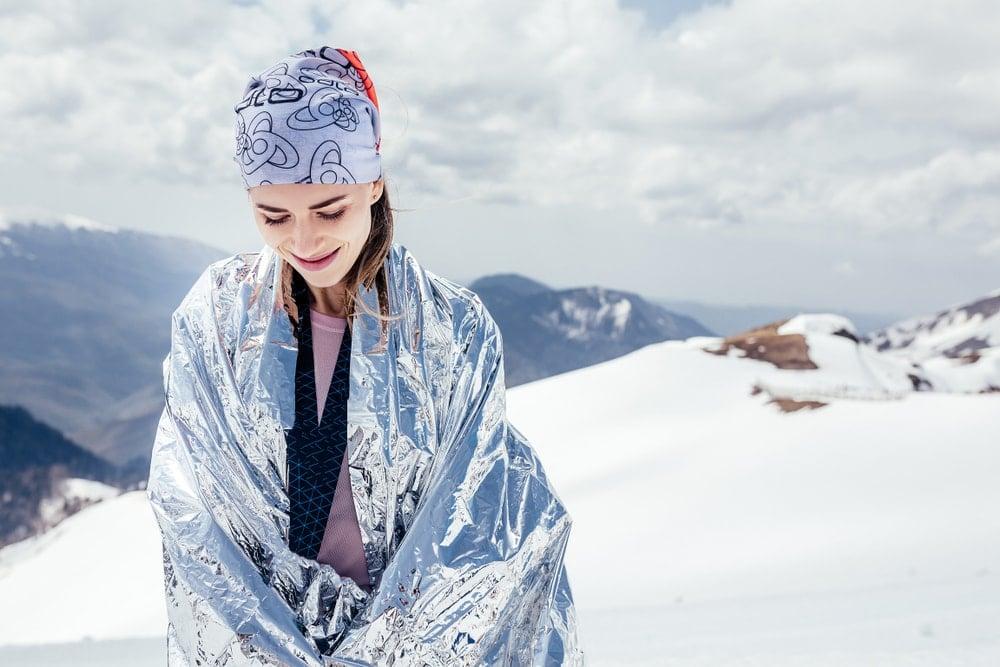 Woman using a thermal blanket