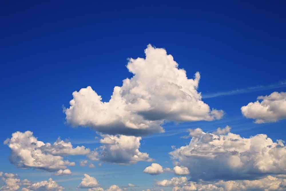 Blue sky with fluffy cumulus clouds