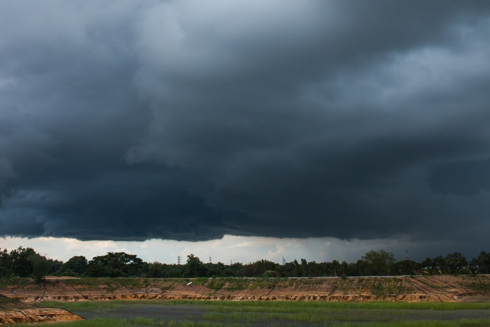 Dark grey clouds aka nimbostratus clouds above a countryside