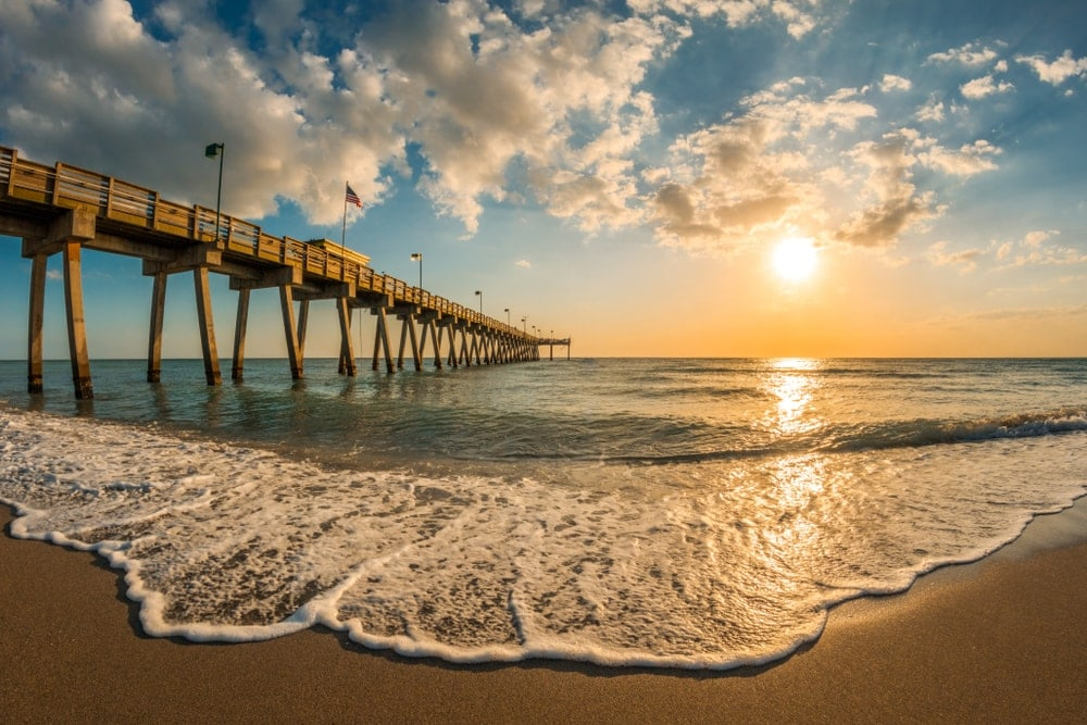 Afternoon sun over Gulf of Mexico and Venice Pier in Venice Florida