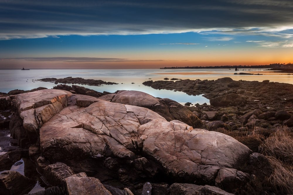 Boulders on the shore during sunset