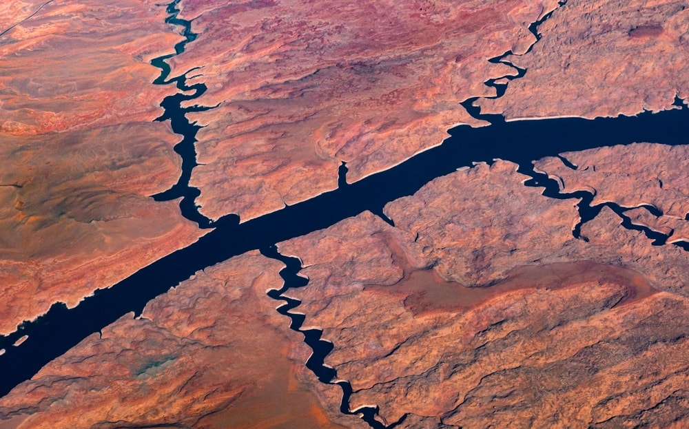 Aerial view of a river and tributary rivers flowing across a desert