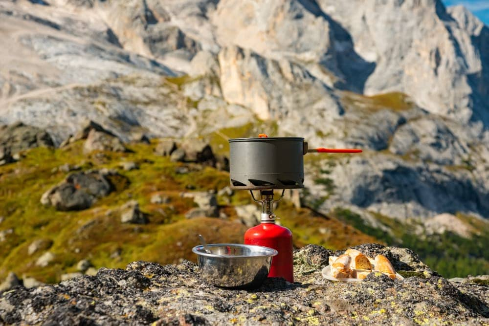 Camp stove and camp food on a mountain