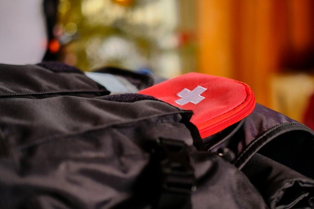 FIrst aid kit inside a backpack pocket