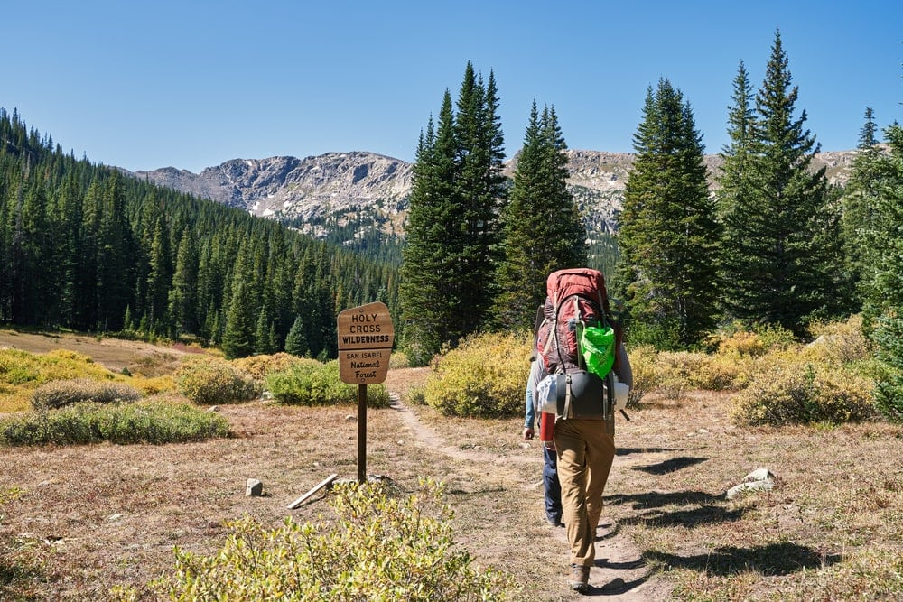 Two hikers passing holy cross wilderness