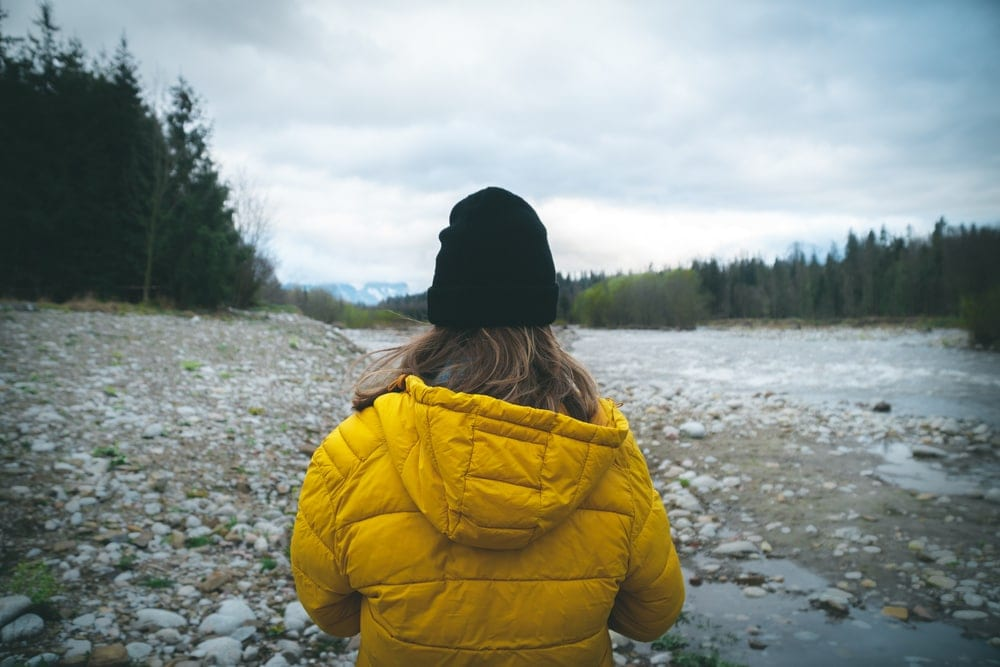 A backpacker wearing yellow jacket during backcountry hiking
