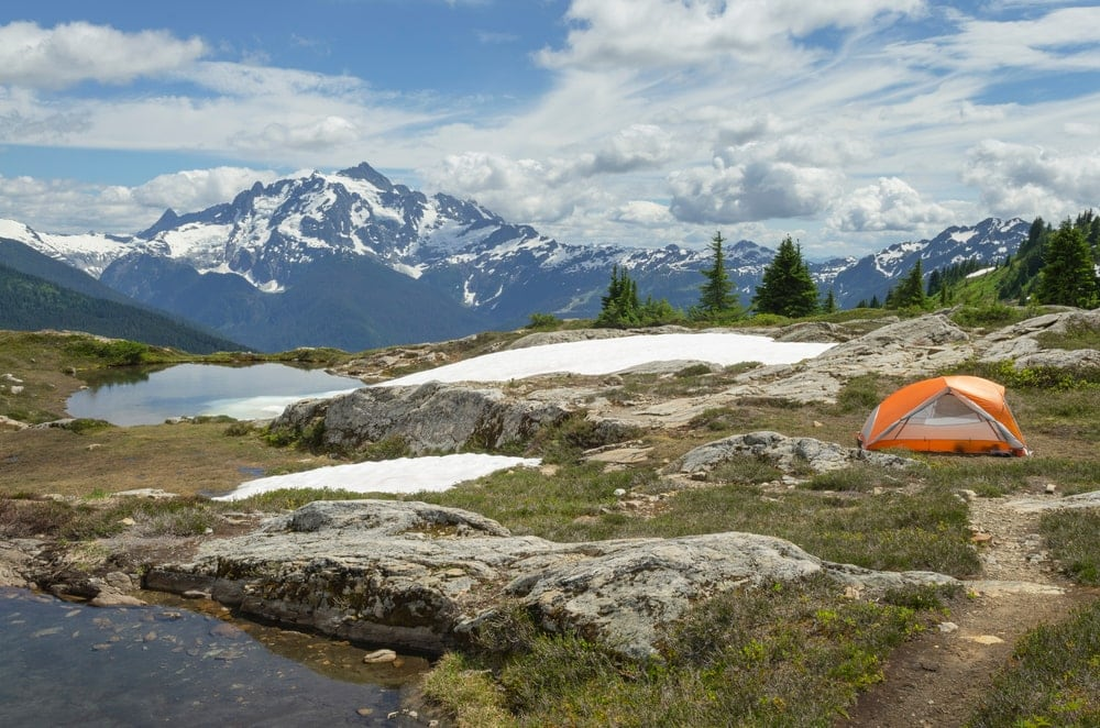 Camping tent in backcountry campsite. with mountain in the background