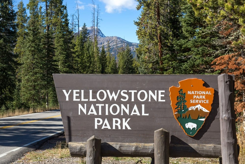 Yellow National Park sign beside the road