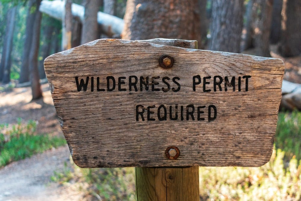 Wilderness backpacking permit required signpost in national parks