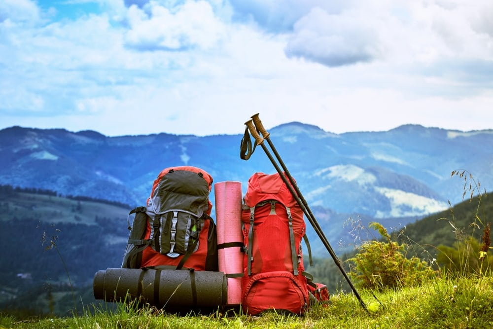backpacks with gear for wilderness backpacking