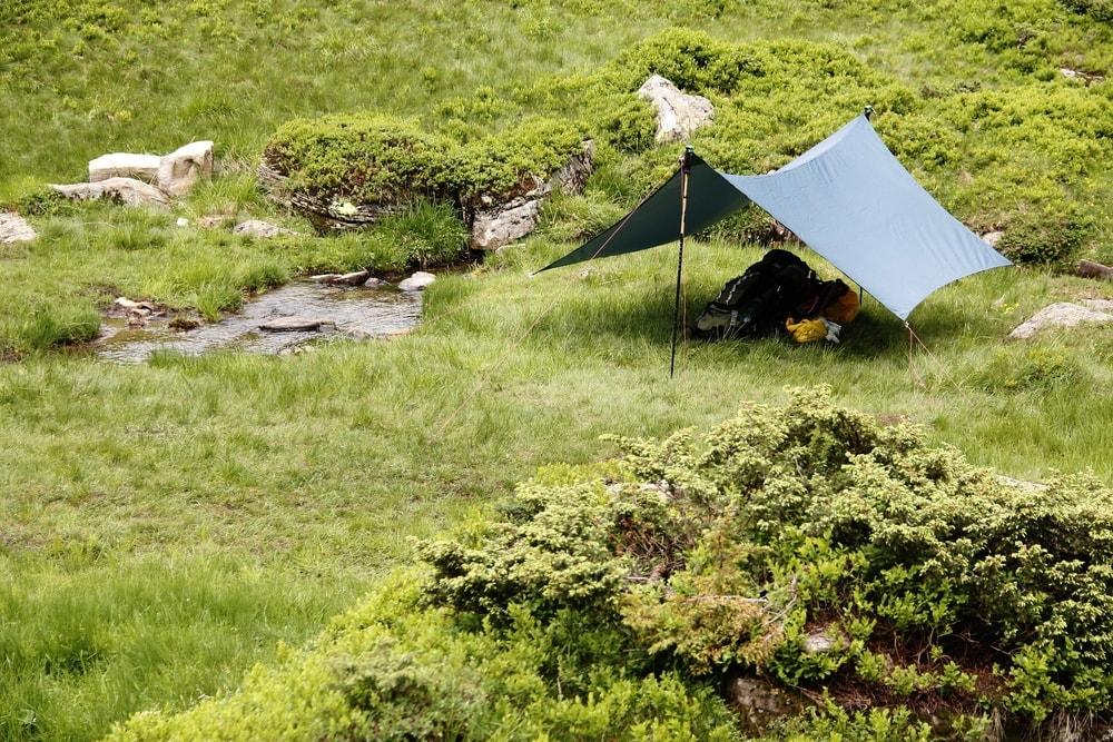 Tarp shelter near a stream
