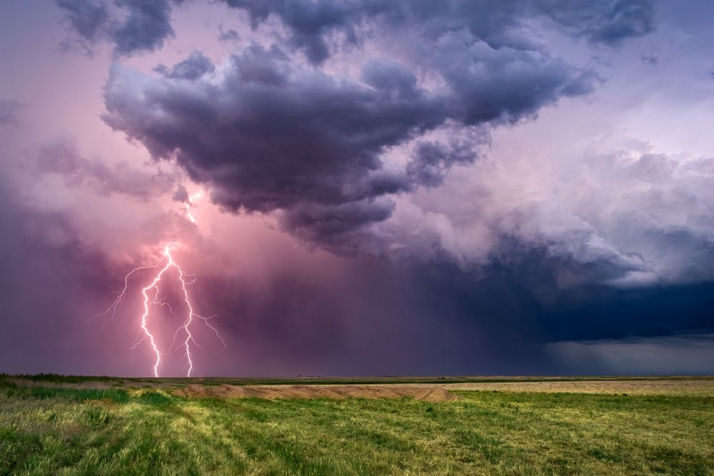 Thunderstorm and lightning on a wide field