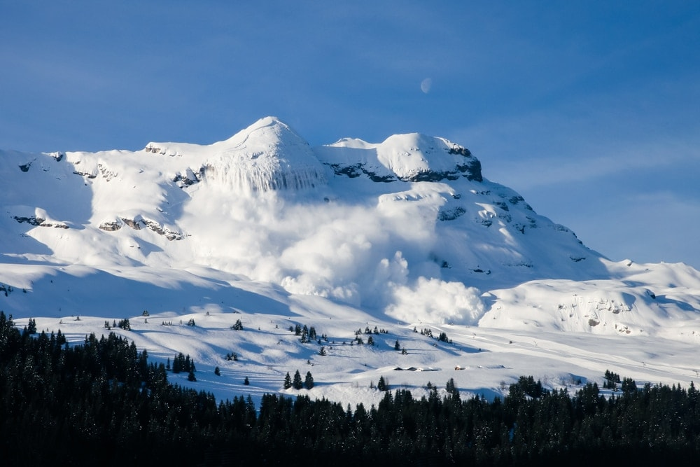 Real avalanche in the Alps, a type of natural disasters