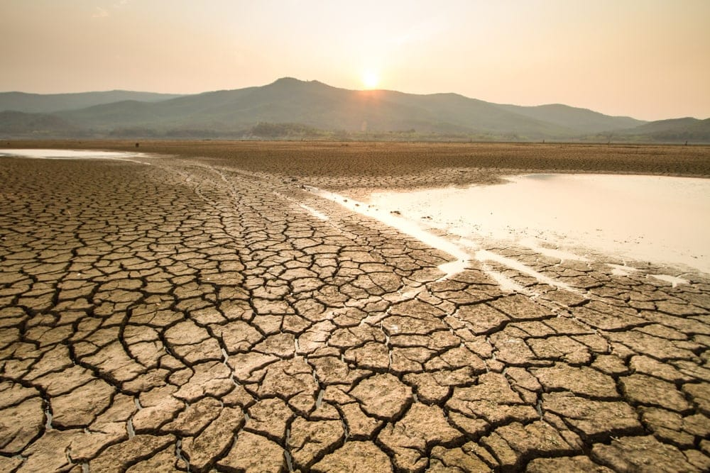 Drying lake on a sunny day caused by drought, a type of natural disasters