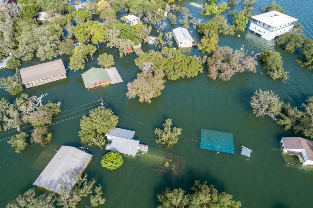 Homes being destroyed and submerged under water caused by a flood
