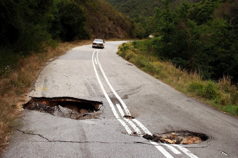 Damaged road with sink holes