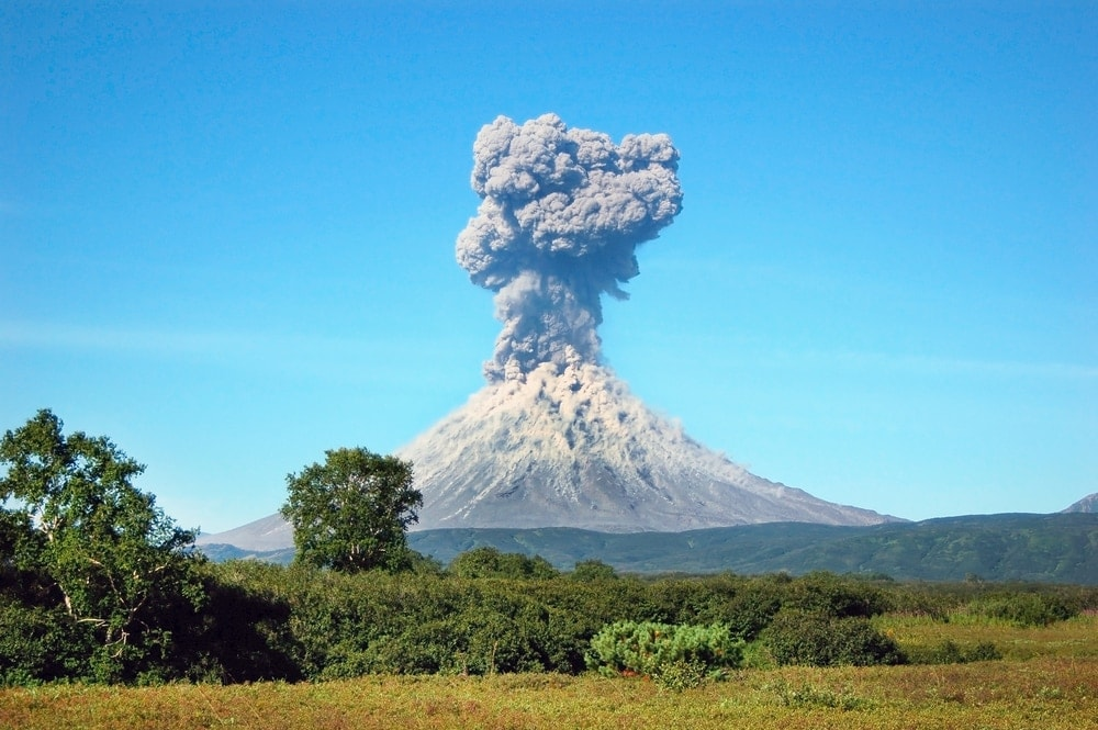 Volcanic eruption with ash rising