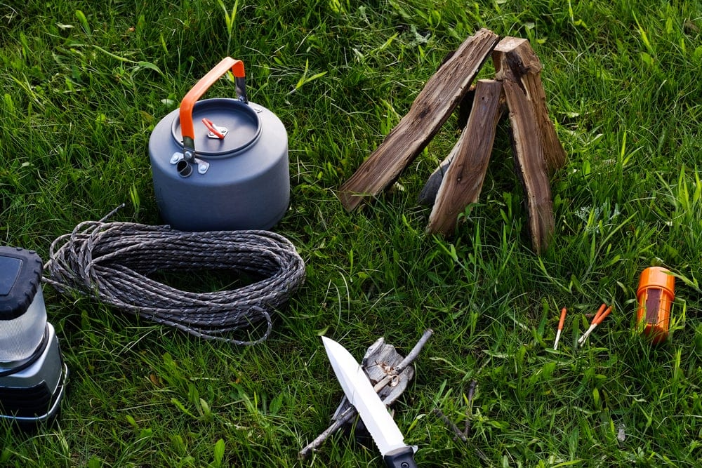 Camping cooking equipment on grass