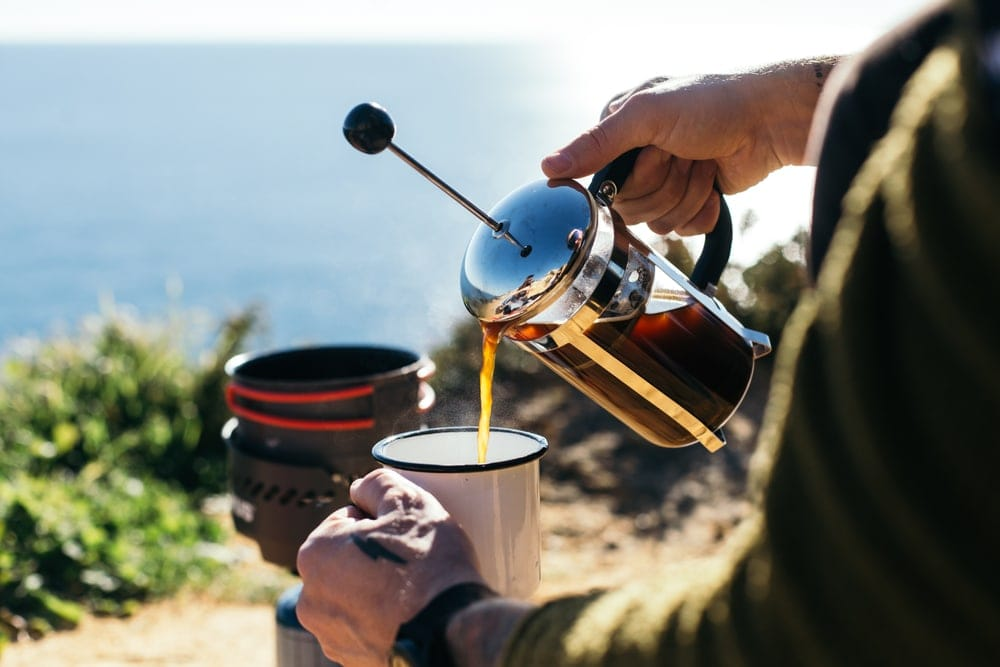 Man pouring a coffee from a french press
