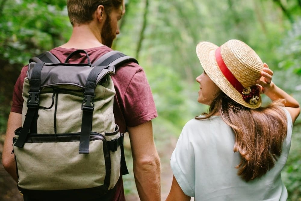 Couple looking at each other while on a hiking date
