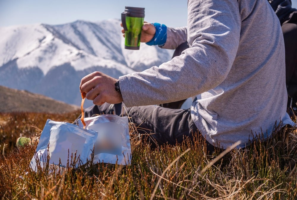 Hiker eating freeze dried food during resting