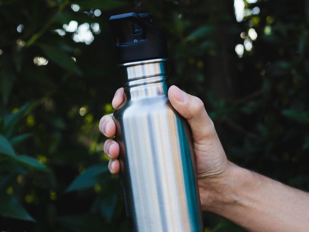 Man holding a hiking bottle