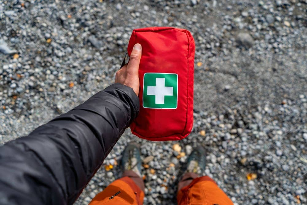 Man holding a first aid kit for hiking