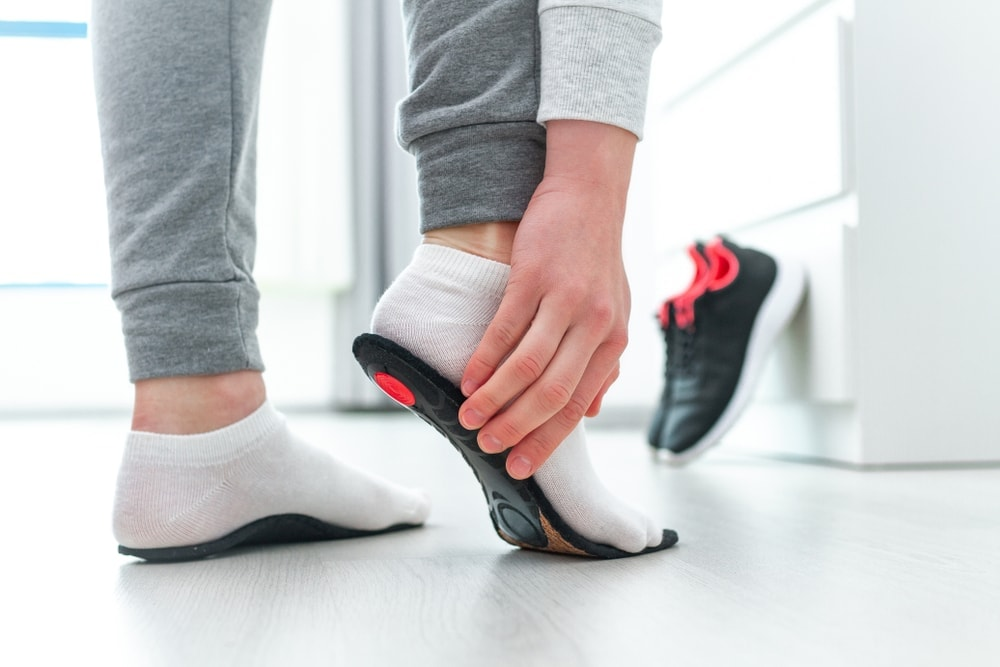 Woman holding a hiking shoe insoles