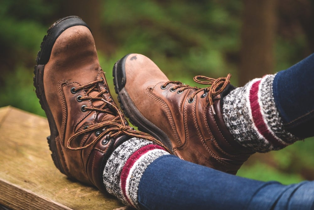 Woman wearing a hiking boots with high socks