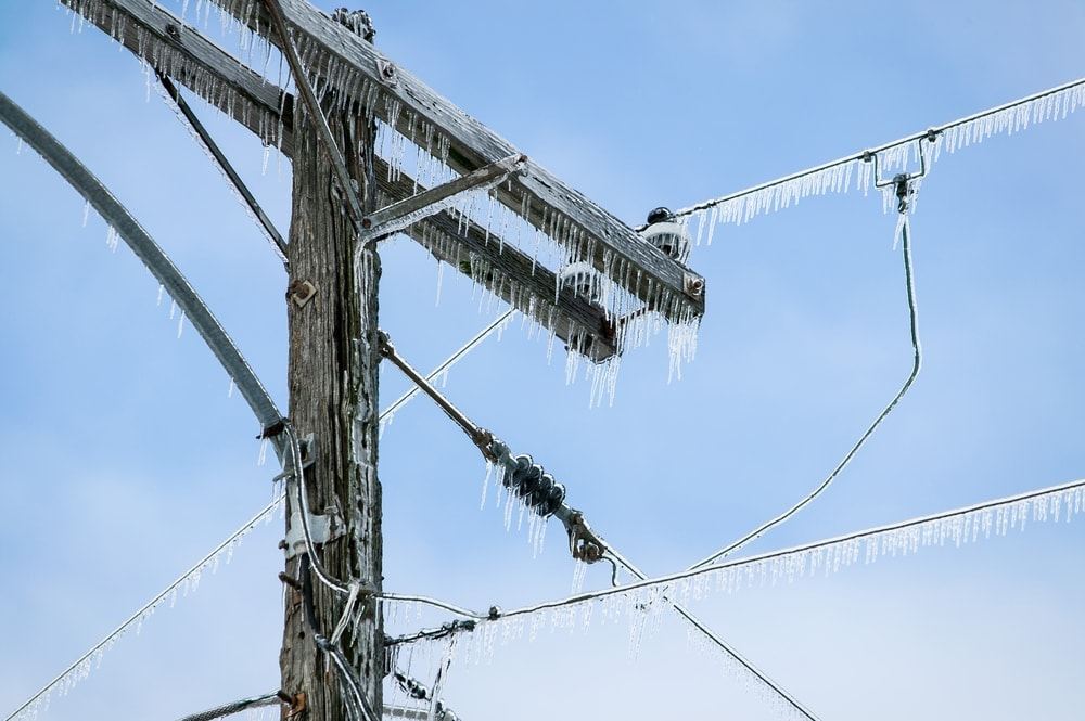 Power line covered by frozen ice from ice storms