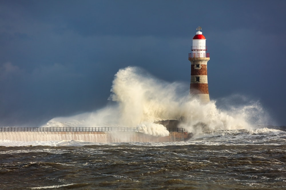 Big waves and lighthouse during a storm