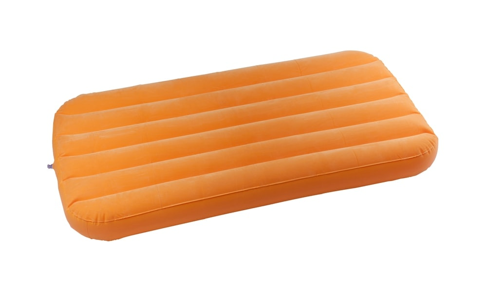Orange inflatable air mattress for camping