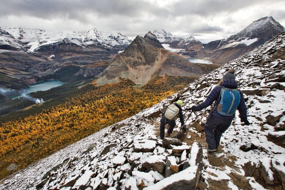 Hikers carefully scrambling down in the mountain